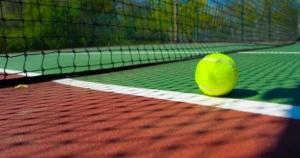 sun setting tennis ball at net